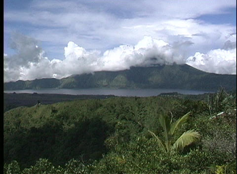 Clouds obscure the view of the peak of Gunung Agung... Stock Video Footage