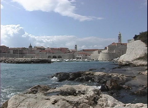 The camera zooms-out from the Dubrovnik coastline in Croatia Stock Video Footage