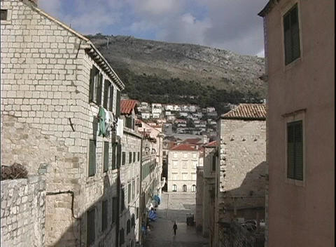 The shot zooms-out from the narrow streets and buildings... Stock Video Footage