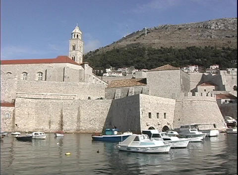 Pan of boats in a small harbor in Dubrovnik, Croatia Stock Video Footage