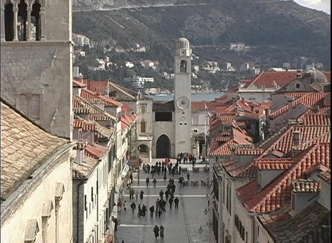 People walking in front of a church in Dubrovnik, Croatia Footage