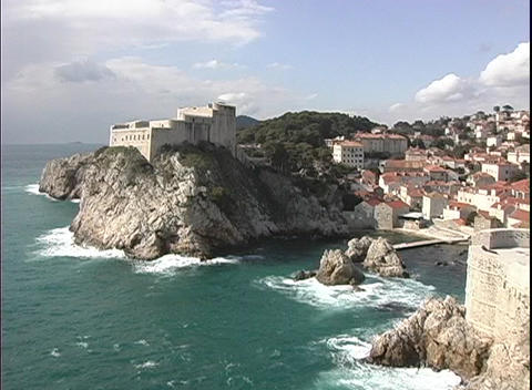Waves crashing against the cliffs near the oceanfront community of Dubrovnik, Croatia Footage