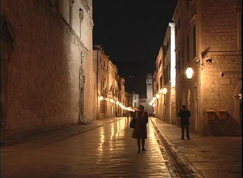 People walk along narrow streets in Dubrovnik, Croatia at... Stock Video Footage