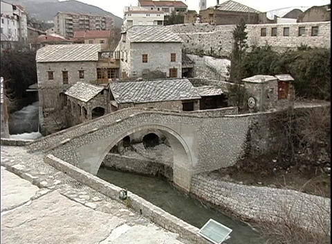 A medium-shot of an arched bridge built over a canal in... Stock Video Footage