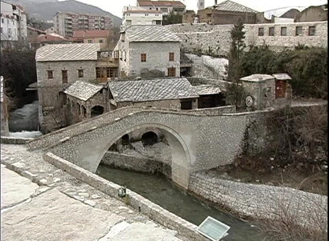 A medium-shot of an arched bridge built over a canal in Dubrovnik, Croatia Footage