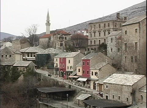A medium-shot of colorful houses on a Bosnian hillside Footage