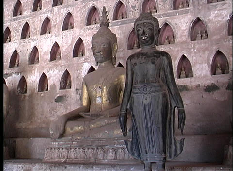 A of two Buddhist statues in Laos Footage