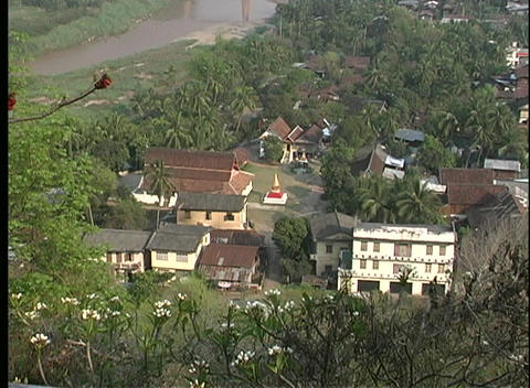 A aerial view of a small religious community near a river... Stock Video Footage