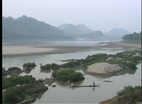 A beautiful view of a river in Asia with fishermen in... Stock Video Footage