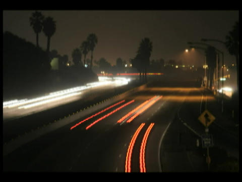 Time-lapse of traffic driving in both directions on a... Stock Video Footage