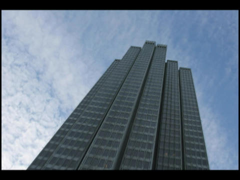 Time-lapse of clouds moving through a blue sky above a... Stock Video Footage