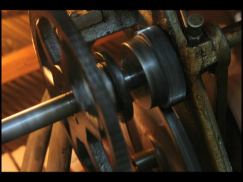 The gears of a player piano spin as it is played Stock Video Footage