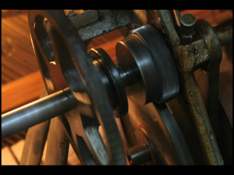 The gears of a player piano spin as it is played Footage