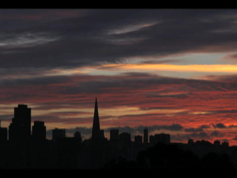 The San Francisco skyline is silhouetted by a darkening sky Footage