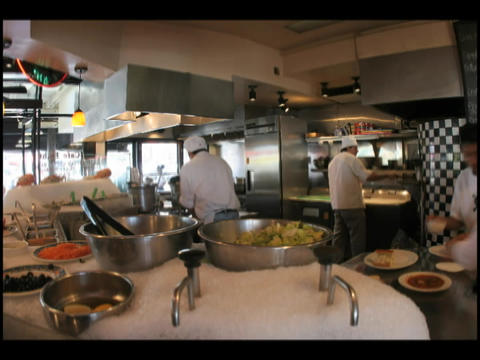 Time-lapse of chefs and cooks preparing food in a... Stock Video Footage