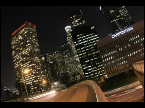 Time-lapse of city traffic and skyscrapers at night Stock Video Footage