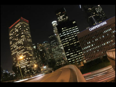 Time-lapse of city traffic and skyscrapers at night Footage