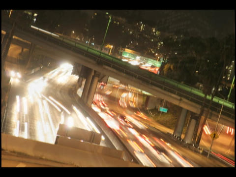 Time-lapse of city traffic on a highway and overpass at... Stock Video Footage