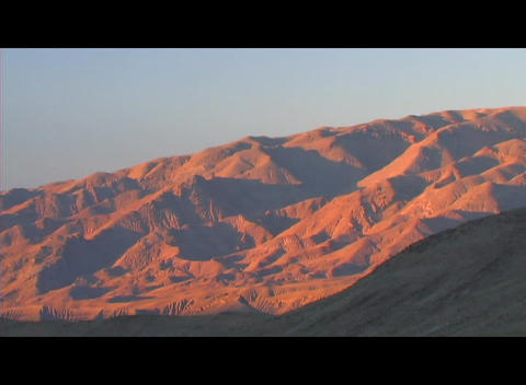 Mountains turn orange in glowing light Footage