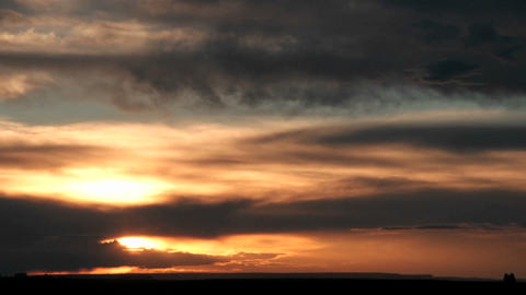 Time-lapse of a darkening colorful sky with moving clouds Stock Video Footage
