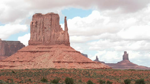 Time-lapse of clouds passing over Mitten Buttes in Monument Valley, Utah Footage