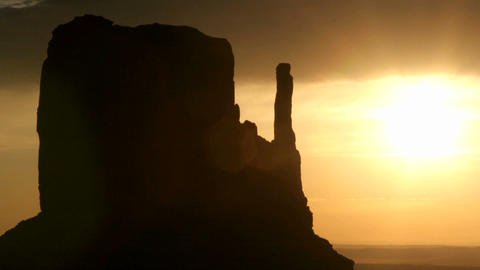 A colorful sky silhouettes Mitten Buttes in Monument... Stock Video Footage