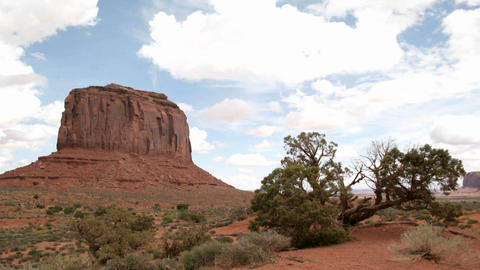 White clouds move quickly over a butte in Monument... Stock Video Footage