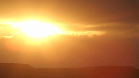 The bright sun disappears behind clouds in a darkening sky Stock Video Footage