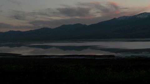A colorful sky becomes dark over a pristine lake in Death... Stock Video Footage