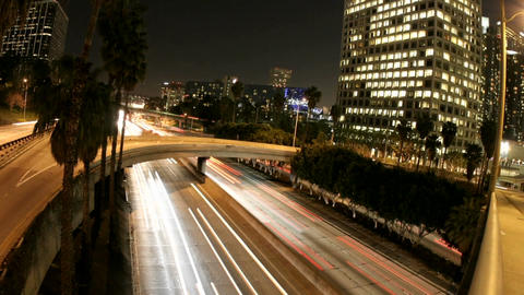 Time-lapse of Los Angeles city traffic on a downtown highway at night Footage