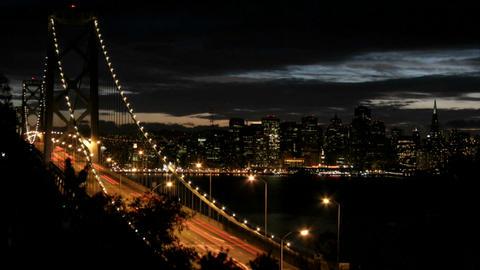 San Francisco's Oakland Bay Bridge grows brighter as... Stock Video Footage