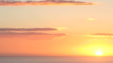 Vivid orange clouds darken to black as the sun slips... Stock Video Footage