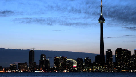 The Toronto skyline brightens as the sky darkens Stock Video Footage
