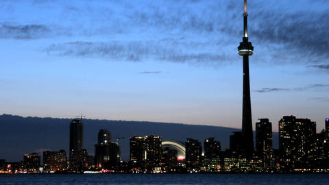 The Toronto skyline brightens as the sky darkens Footage