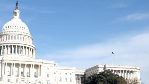 Clouds pass quickly over the United States Capitol Building Stock Video Footage