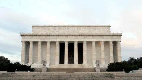 Pedestrians and tourists walk around and through the Lincoln Memorial in Washington, DC Footage