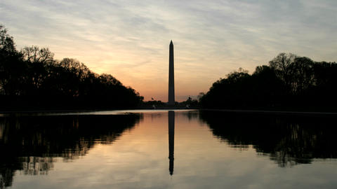The Washington Monument is silhouetted against a colorful sky in Washington, DC Footage