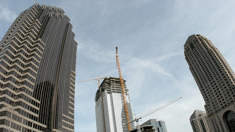 Clouds roll over skyscrapers and a construction site as a day passes in downtown Atlanta, Georgia Footage