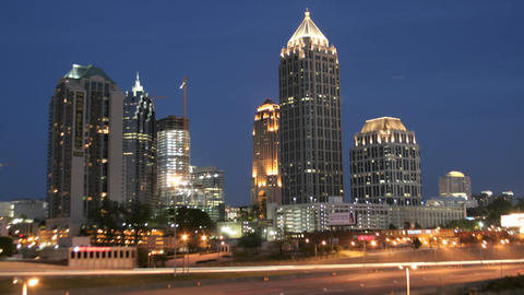 Lights illuminate downtown Atlanta, Georgia as the evening fades into night Footage