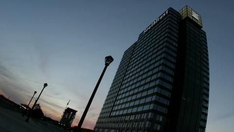 Skies change from light to dark behind a skyscraper in downtown Atlanta, Georgia Footage