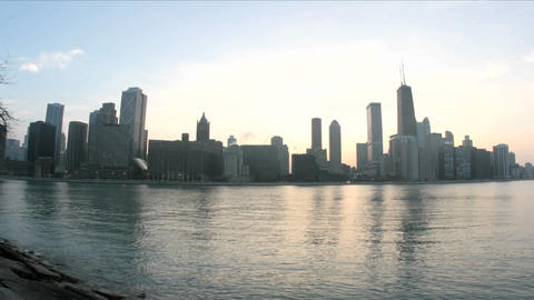 Lake Michigan reflects the Chicago skyline as evening... Stock Video Footage