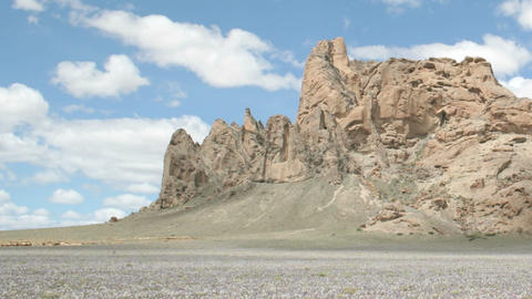 Slow right pan of a time-lapse shot of New Mexico's Shiprock Stock Video Footage