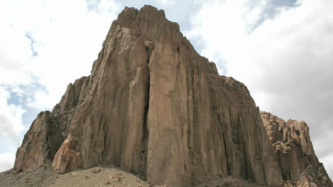 Slow upward pan of New Mexico's Shiprock Stock Video Footage