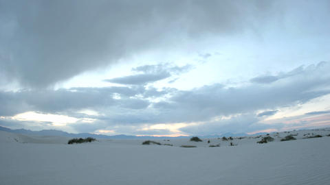 Time lapse shot clouds passing over White Sands National Monument throughout the day, and into the n Live Action