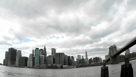 Thick, white clouds pass over the New York City skyline Footage