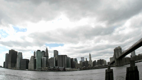 Thick, white clouds pass over the New York City skyline Stock Video Footage