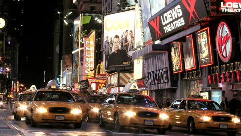 Accelerated traffic moves past billboards in New York's Times Square Footage