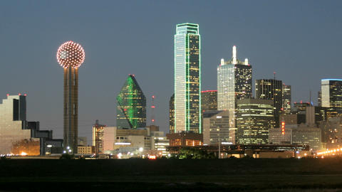 Slow pan of city lights illuminating the Dallas skyline... Stock Video Footage