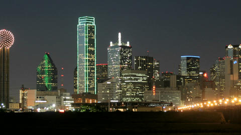 Slow pan of city lights illuminating the Dallas skyline... Stock Video Footage