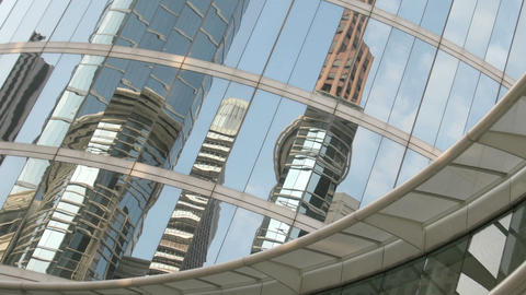 Slow pan of skyscrapers reflected in the mirrored walls... Stock Video Footage